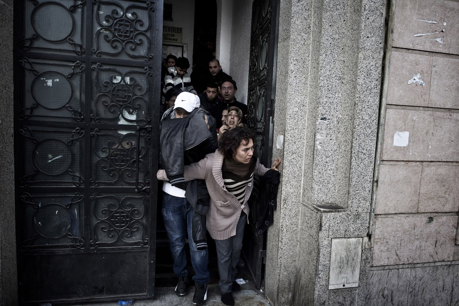 Jan. 14, 2011. Tunisian demonstrators hide from the police and try to take refuge from tear gas in Tunis.
