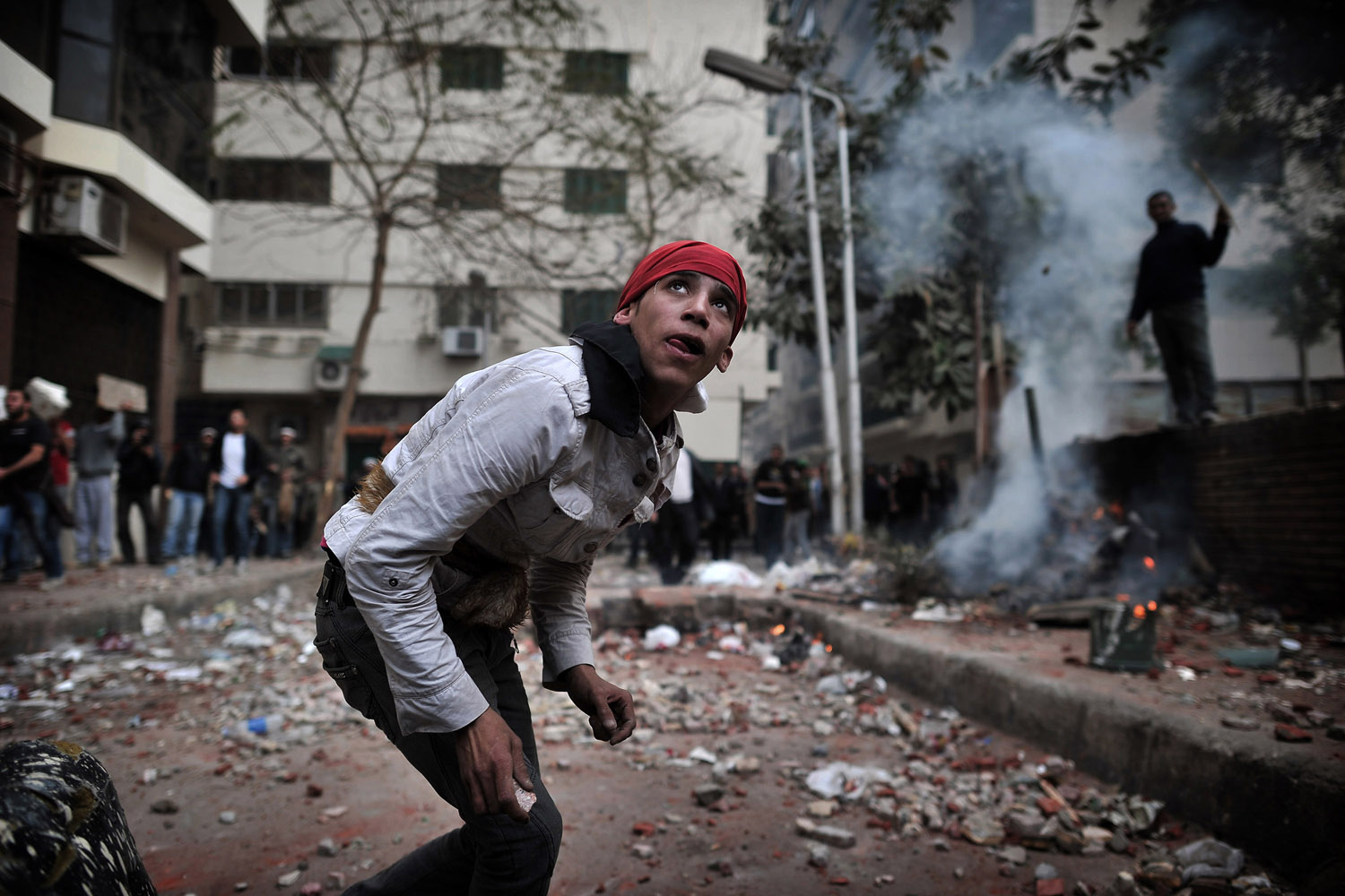 Feb. 3, 2011. Young anti-Mubarak Egyptians throw stones in Tahrir Square in Cairo.