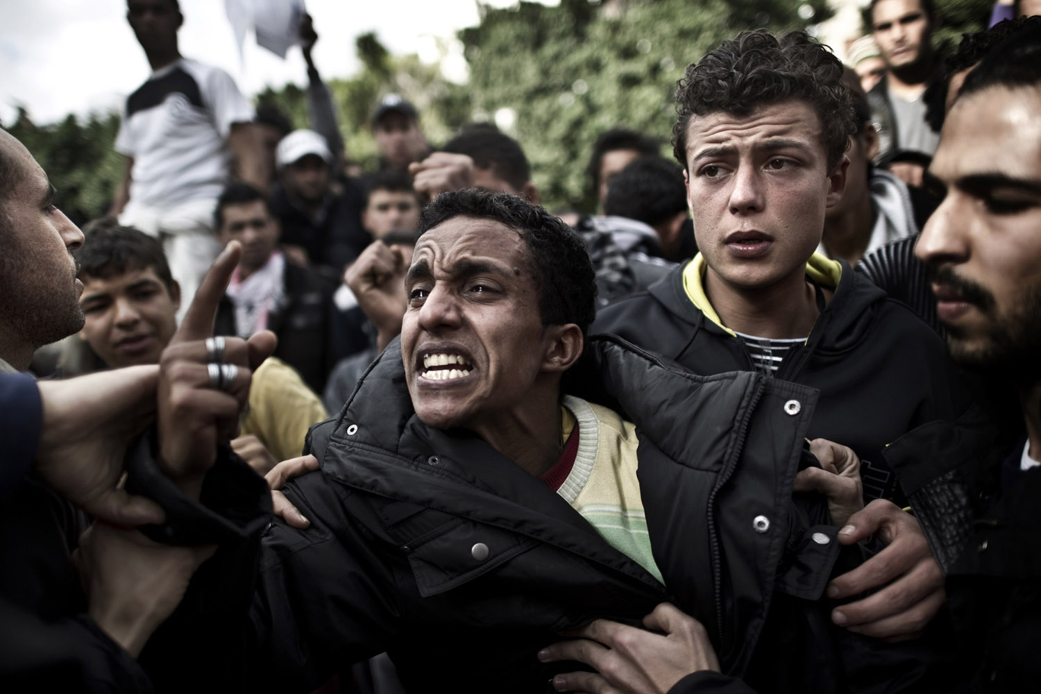 Jan. 14, 2011. A young Tunisian protestor cries in front of the interior ministry in Tunis because secret police tortured and killed his brother five years ago.