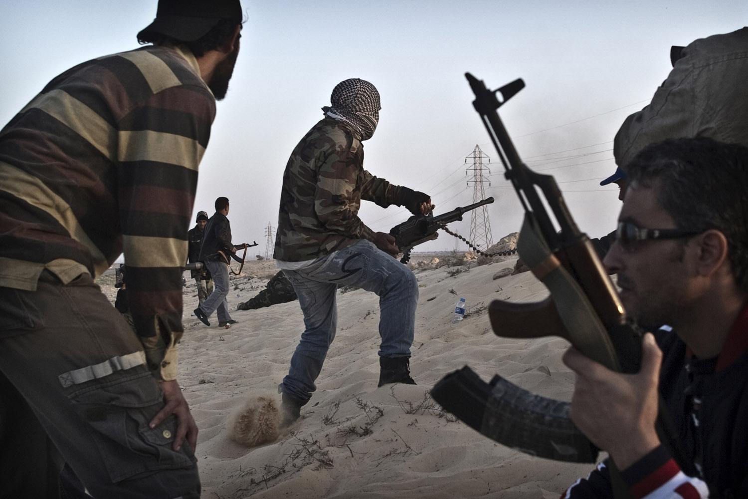 March 25, 2011. Libyan opposition fighters hold their position outside Adjabyia.