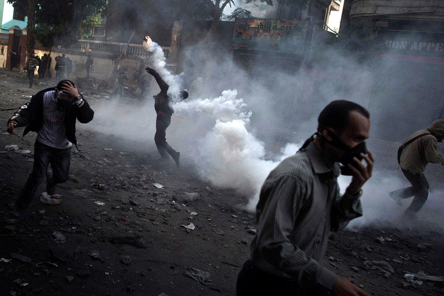 Nov. 22, 2011. Egyptians frustrated by army rule battle police in Cairo.