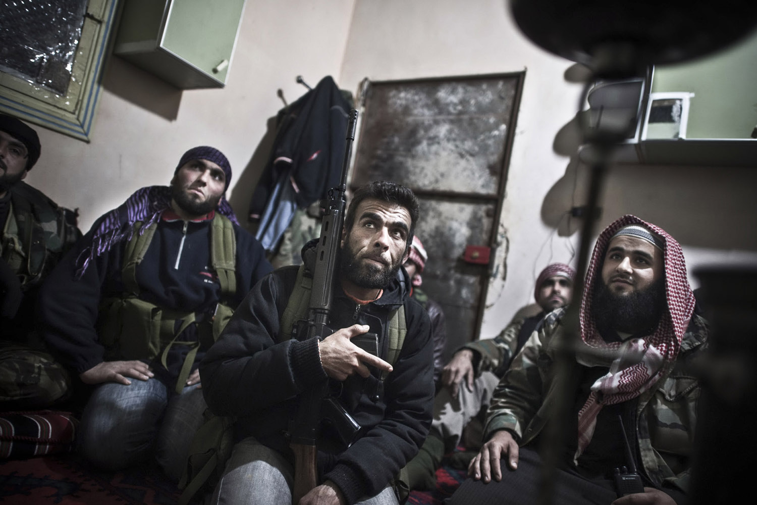 February 22, 2012. Free Syrian Army fighters pray before trying to enter Baba Amr in Syria.