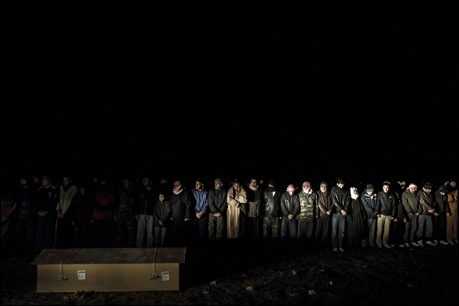 February 22, 2012. At 3AM, people in the village of Bouyada attend the funeral of four young men who were crushed in their home after a shelling by Assad forces. Most of the time, funerals take place during the middle of the night to avoid attacks by the army.