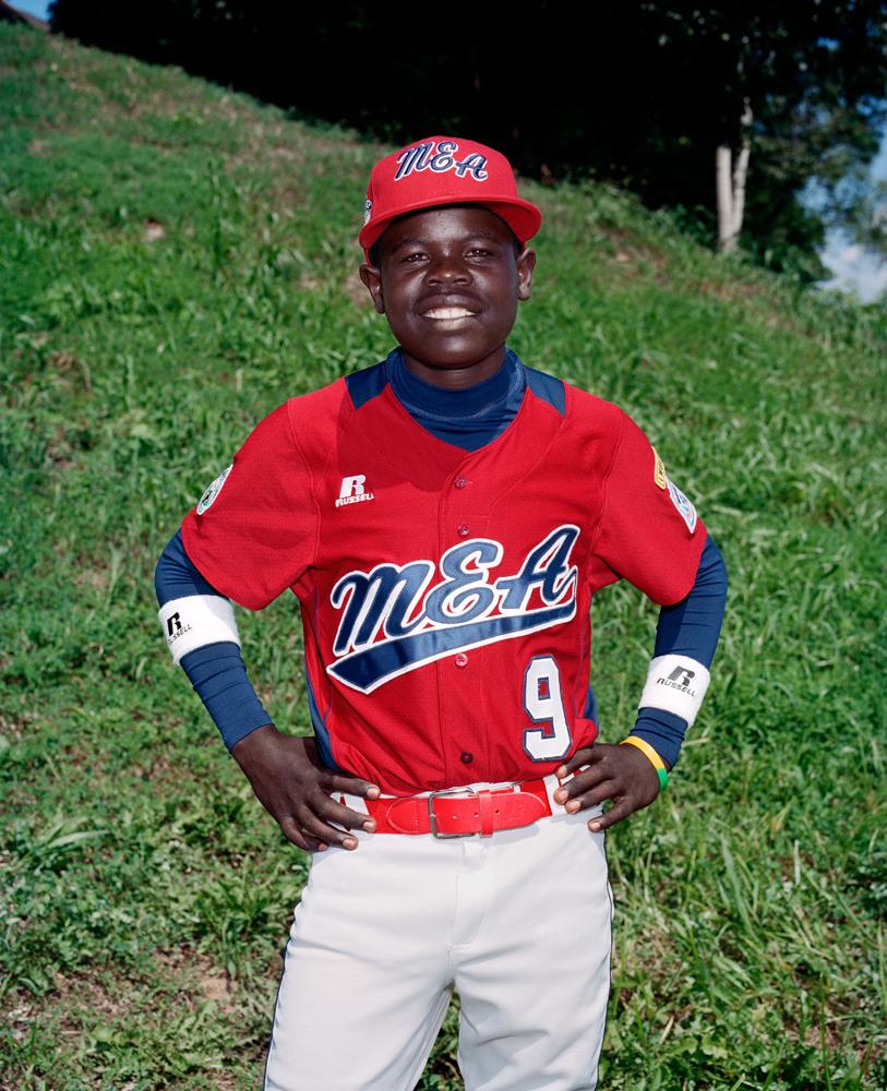 Felix Enzama #9, pitcher for Lugazi Little League. They were the 2012 MEA Champions.