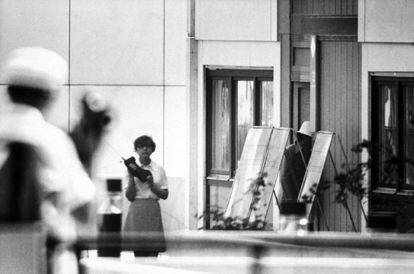 An Arabic-speaking German policewoman relays information to authorities by walkie-talkie after speaking with a Black September terrorist, Munich, September 1972.