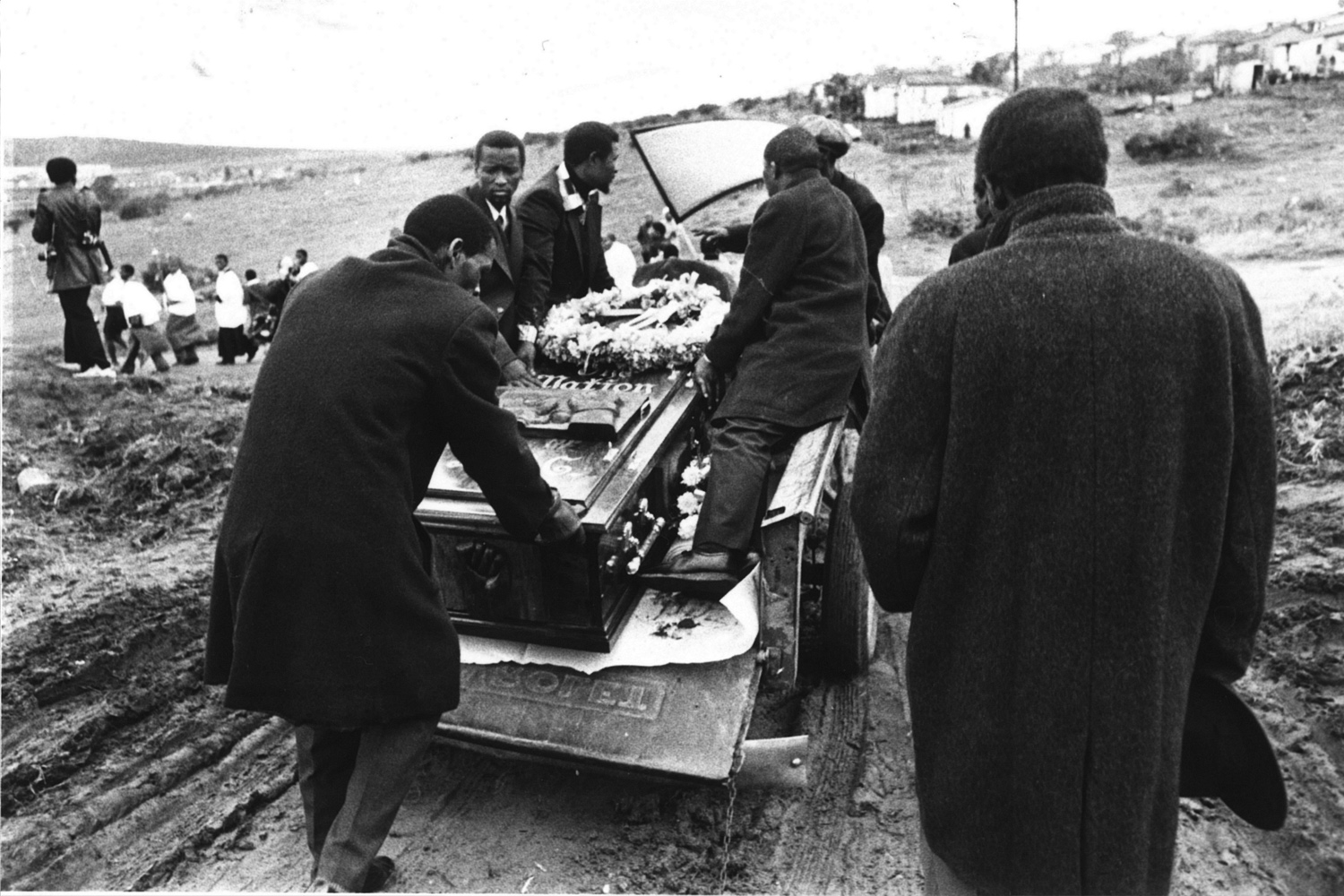 The coffin was carried to the cemetery in an ox-cart, followed by thousands of mourners. 1977.