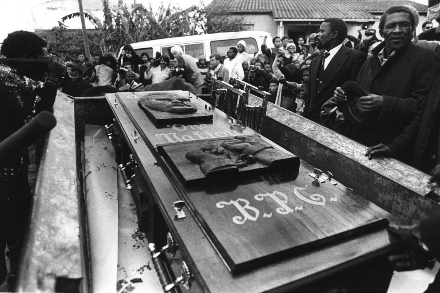 The coffin that carried Biko to the grave also carried a carving of his face and his organization's motif. 1977.