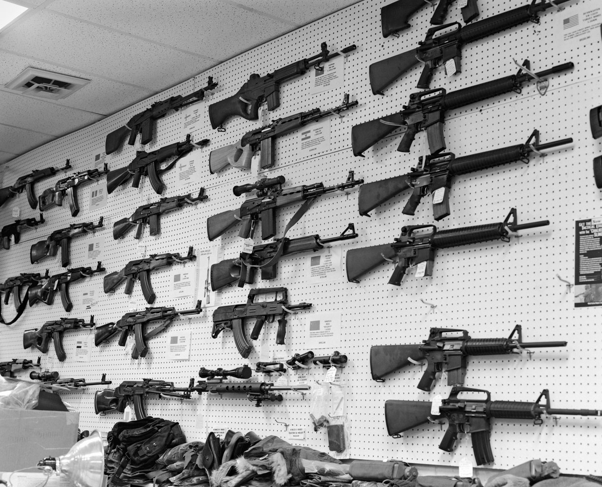 A Selection of high-velocity assault rifles on display in Paladin Arms gunstore in Longmont, Colo., shortly after the massacre at nearby Columbine High School. These are available over-the-counter to anyone over the age of 18, under Colorado State law.