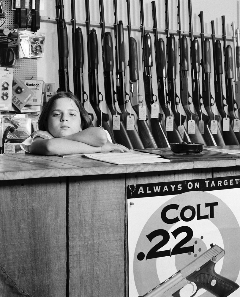 Sarah Read, 10, at Top Brass Sports Inc. gun store.  I got a 410 shotgun form Santa Claus last year.
