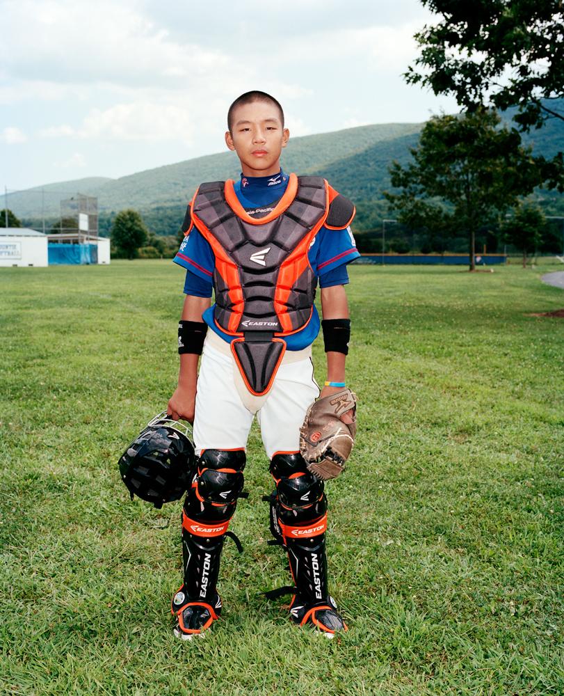 Yao-Jung Chuang #15, catcher for Taiwan's Kuei-Shan Little League.