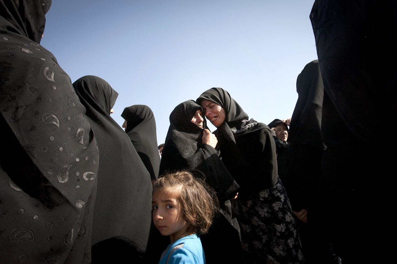 Aug. 12, 2012. Iranian women mourn after a deadly earthquake in northwest Iran.