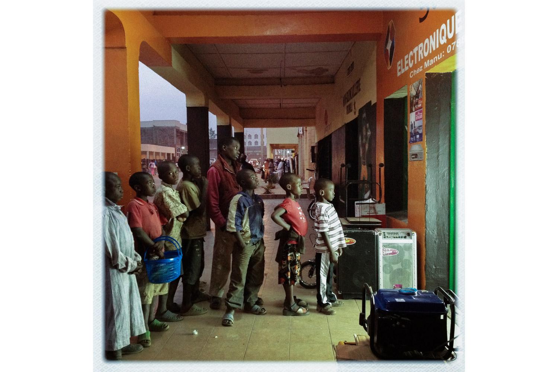 Children gaze into an electronics shop in Gisenyi, Rwanda, across the border from Goma.