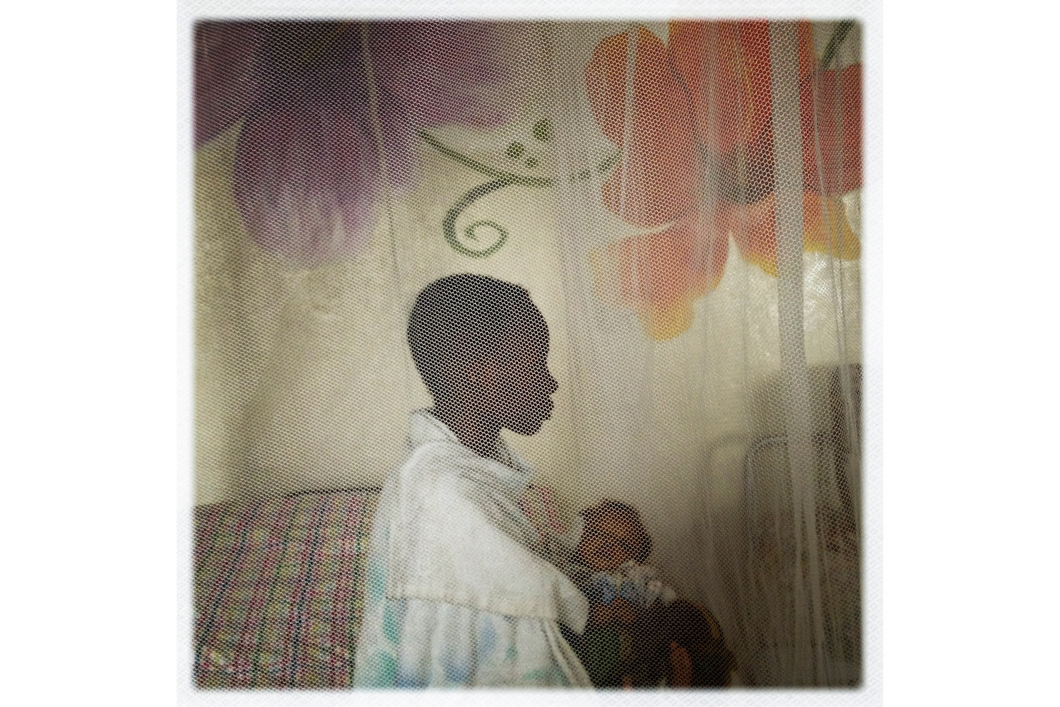 A teenage girl, who was gang-raped by three militia men, sits with her baby at a Heal Africa clinic in Goma. Control over the mines, and the income they provide, has fueled conflicts in the area for decades, including violence against women.