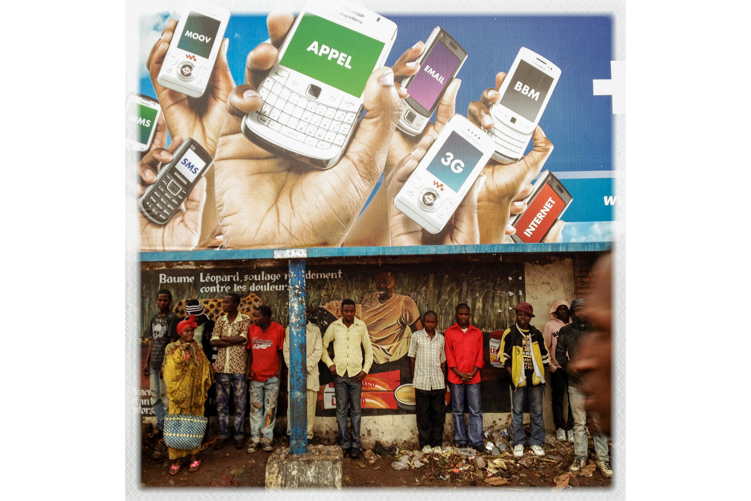A mobile phone ad beside the road in Goma, DRC.
