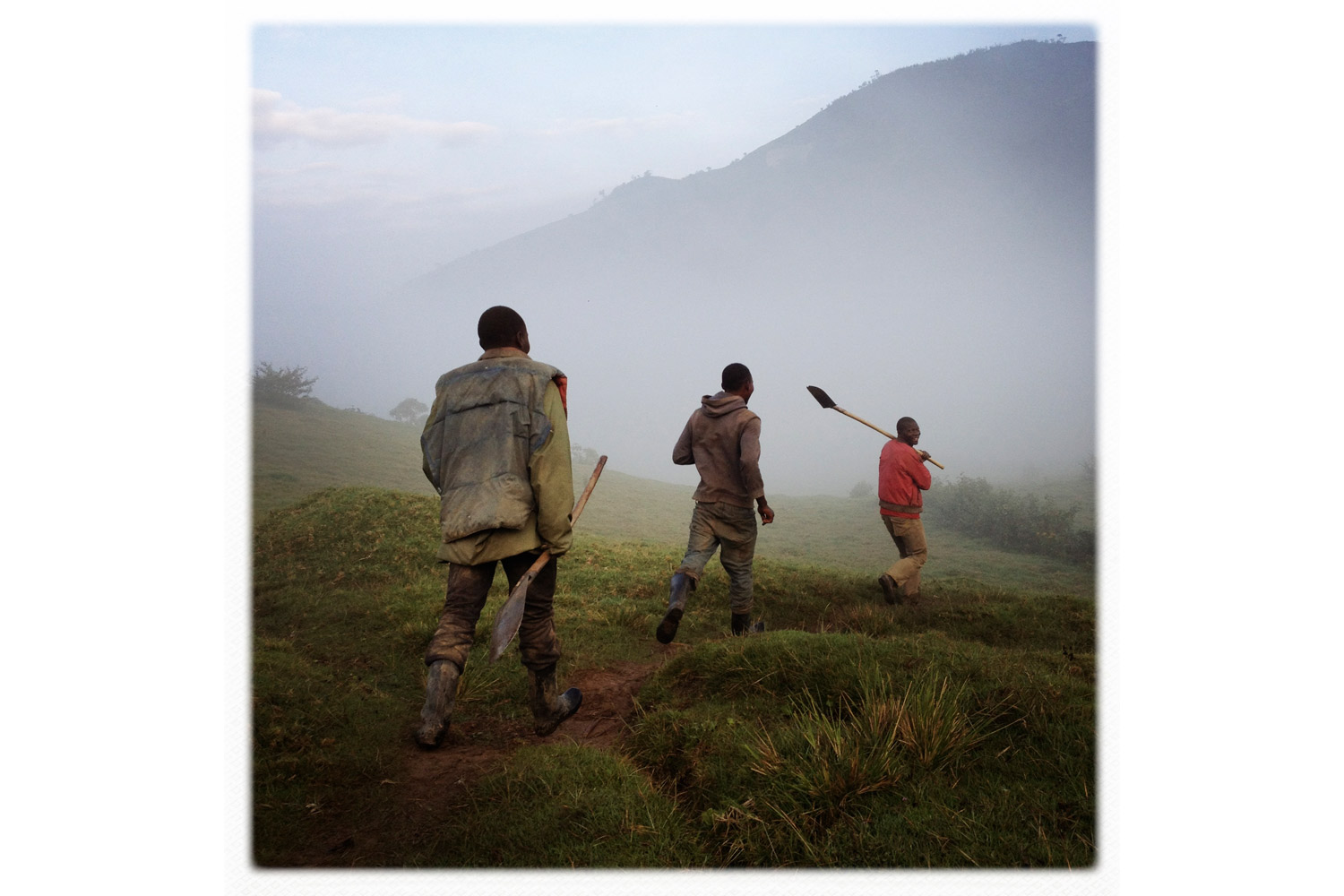 Workers walk to a cassiterite, coltan and tourmaline mine near the town of Numbi, South Kivu, Democratic Republic of Congo. The minerals are used to make key components in electronic devices, including mobile phones.