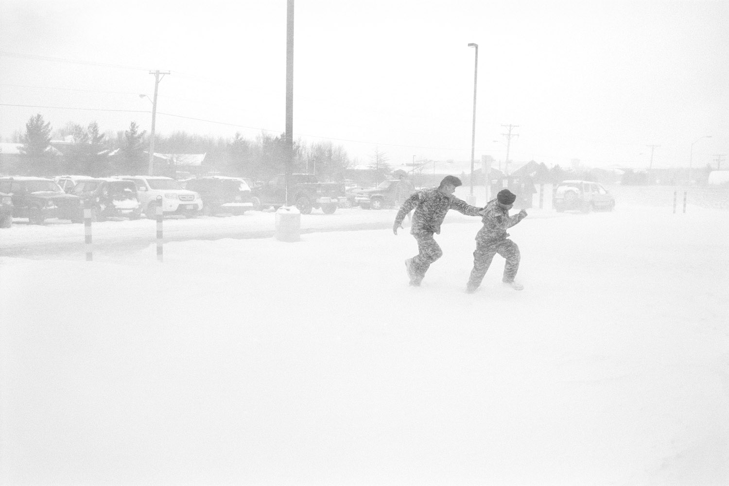 Two soldiers play in a blizzard at Fort Drum, N.Y. January 2010.