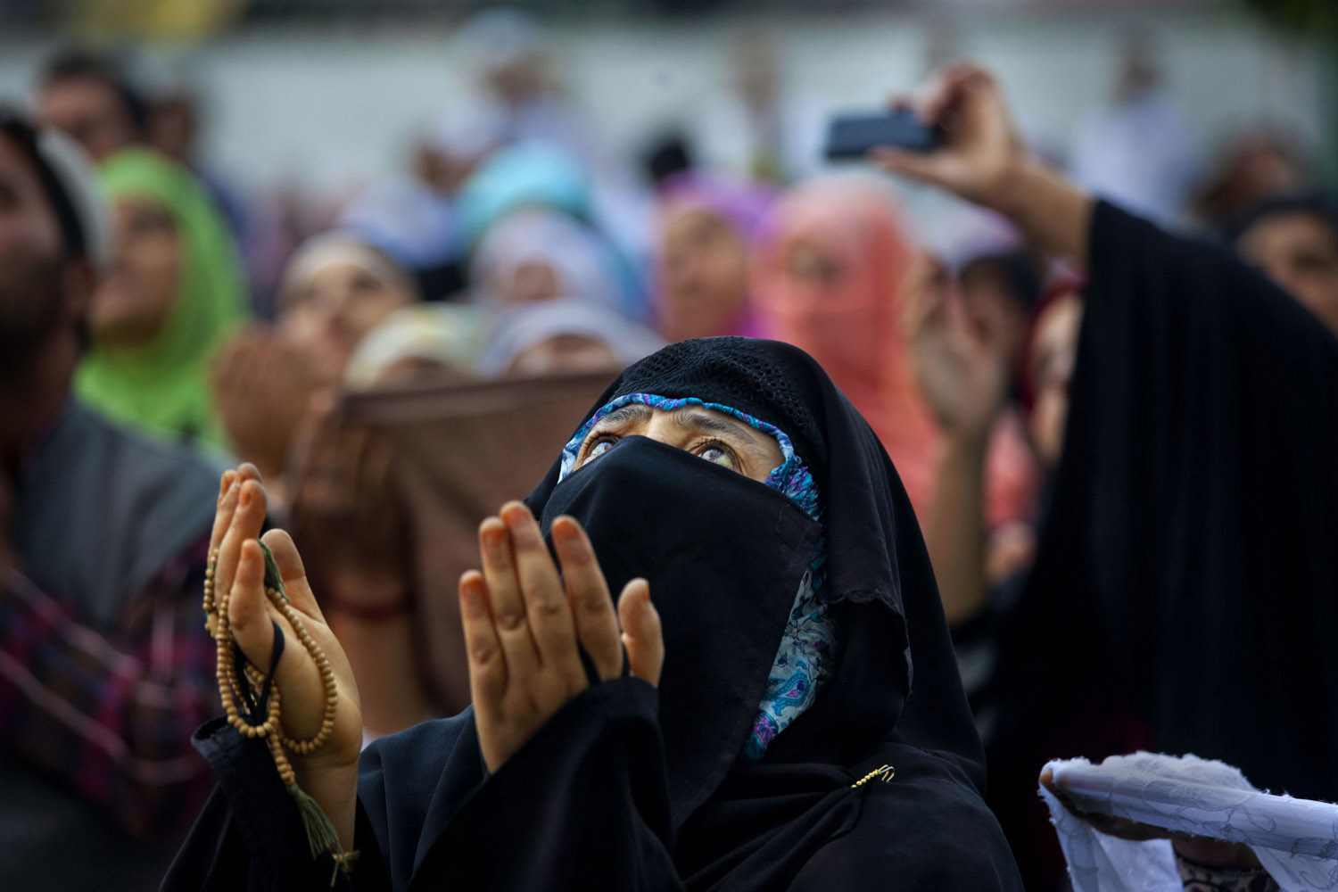 Aug. 10, 2012. A Kashmiri Muslim woman prays during special prayers to observe the Martyr Day of Hazrat Ali, cousin of Prophet Mohammed, on the 21st day of Ramadan in Srinagar, India.