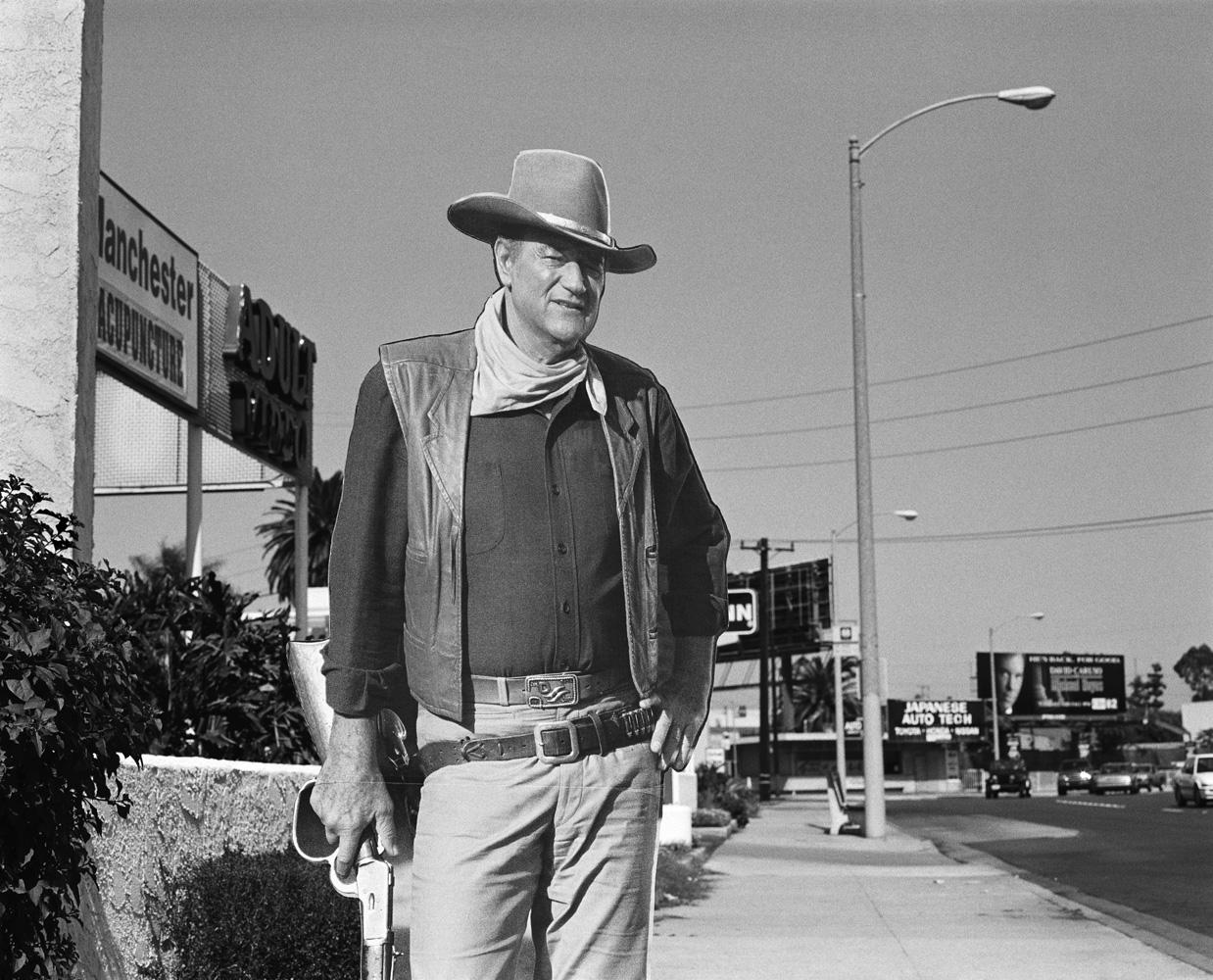 A John Wayne cut-out sign outside a firing range and gun shop in Las Vegas.