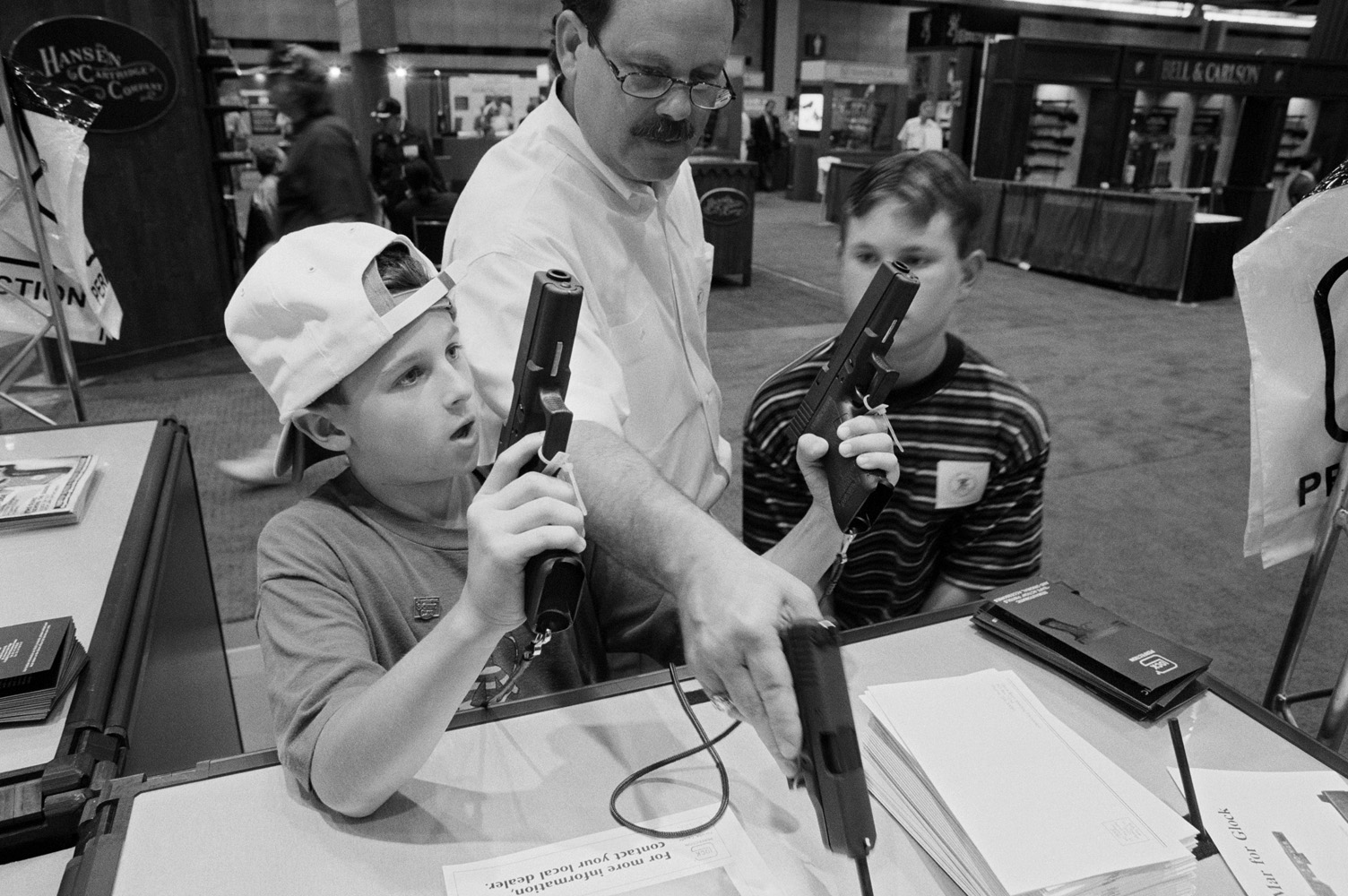 Jack Cone, 45, with sons Andrew, 10, and Tanner, 12, at the National Rifle Association (NRA) annual convention and gun show in Dallas.  Tanner first fired a gun aged 3. He now owns a 243 Ruger rifle, a Remington 58 and a 20-guage automatic shotgun. Andrew has a Browning Rifle, a Remington pump-action shotgun and a Swedish military rifle. I've got about 50 guns. The real problem is the minorities who have guns—they cause the problems.