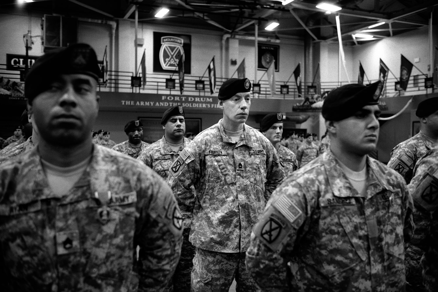 After returning home from a 12-month deployment in Afghanistan, U.S. soldiers from the 10th Mountain Division receive awards for  valor at the MaGrath Gym in Fort Drum, N.Y.  January 2010.