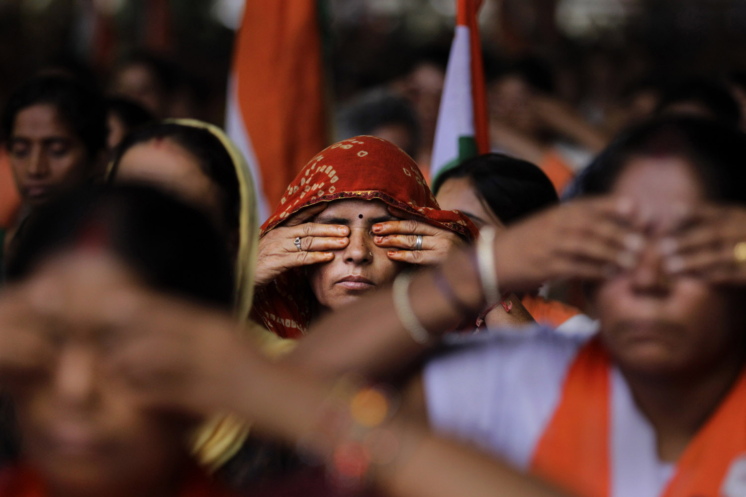 Aug. 10, 2012. Supporters of Indian yoga guru Baba Ramdev perform yoga during an anti-corruption protest in New Delhi.