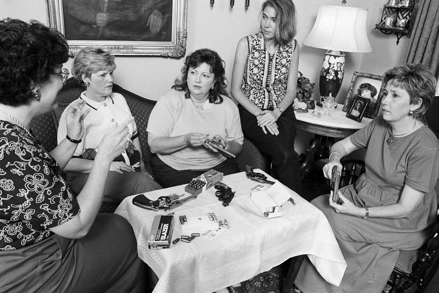 Memphis housewives meet and compare recently purchased weapons.                               Susan Wilson (center), 44, says,  I'll be carrying a 9mm semi-automatic from now on. Things are getting dangerous out there. I hope and pray that the person I shoot doesn't die. That'd be great, but I'm goin' to shoot so that I don't die.