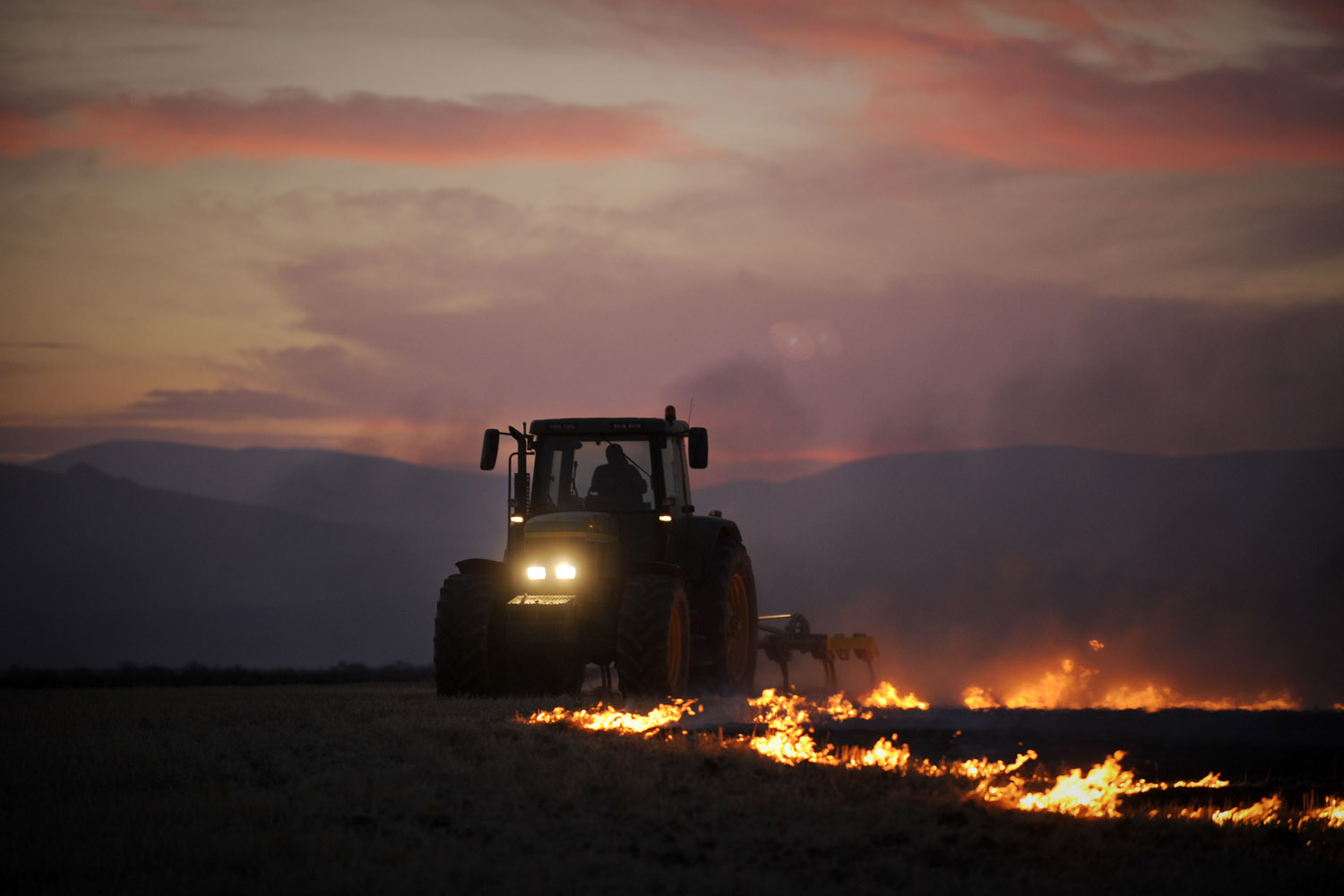 Aug. 11, 2012. A neighbor works in El cubillo de Uceda during a forest fire near Guadalajara, Mexico.