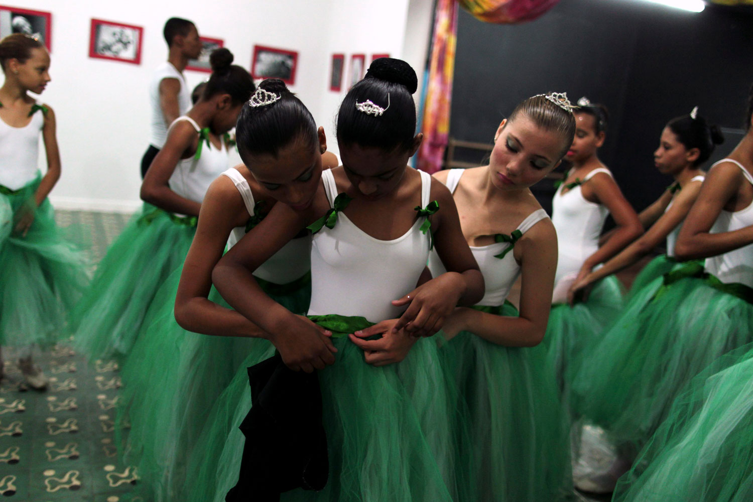 Aug. 13, 2012. Girls fit their ballet skirts during their ballet class at the 'Ballet Santa Teresa' academy in Rio de Janeiro. 'Ballet Santa Teresa', a non-governmental organization (NGO) gives children who live in areas with social risk, some suffering domestic violence, free ballet classes and other activities as a part of socio-cultural integration project.