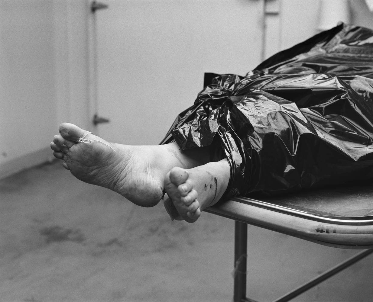 The body of a female gunshot victim in the cold storage room of Memphis City Morgue. A high proportion of women wounded or killed by gunfire are shot in their own homes during domestic arguments.