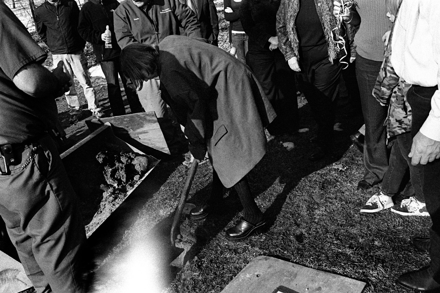 Friends and family, as a symbolic gesture to bid their farewells, shovel dirt over the ashes of U.S. Soldier Specialist Dirk Terpstra, 26, who, after serving a 12-month tour in Afghanistan in 2009, committed suicide near his home in Michigan. March 8, 2010.