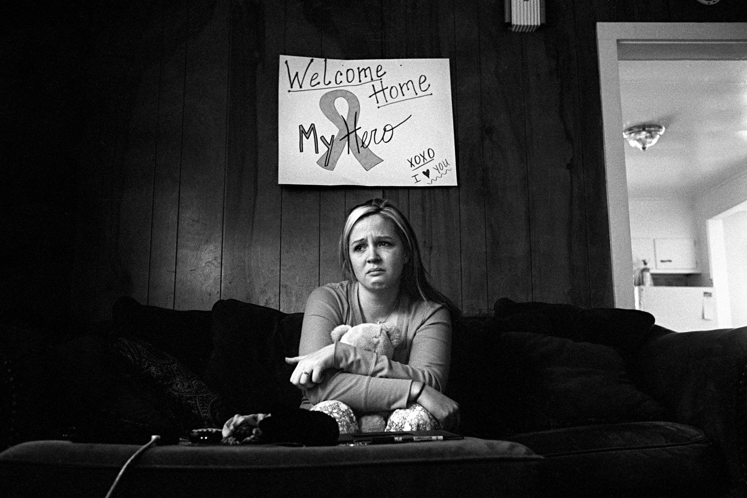 Stefanie Strausser mourns the death of her fiance, Staff Sergeant Cody Anderson at their apartment in Watertown, N.Y. January 2010.
