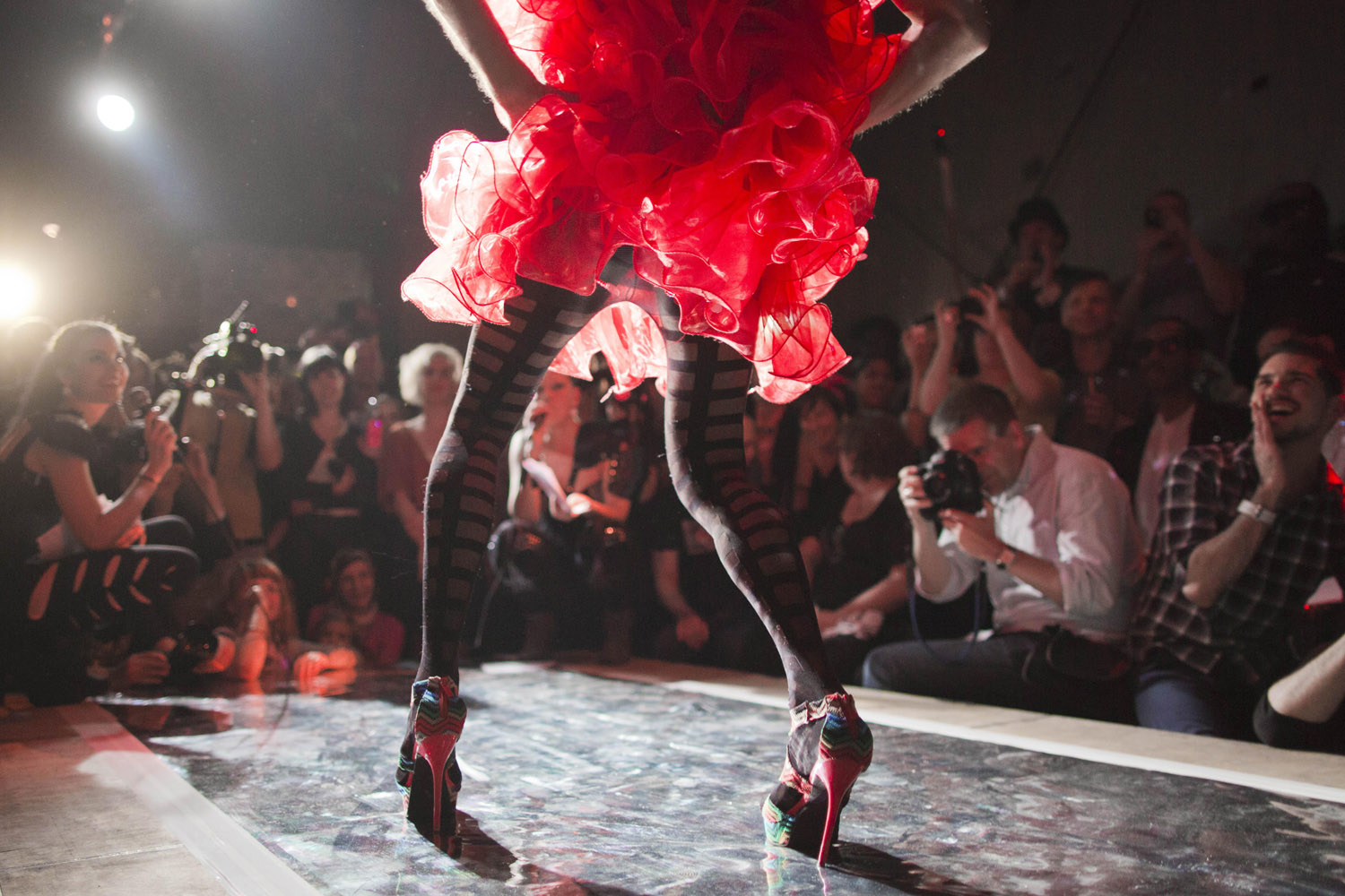 Aug. 11, 2012. A competitor performs on the catwalk at the first German Voguing Festival in Berlin.