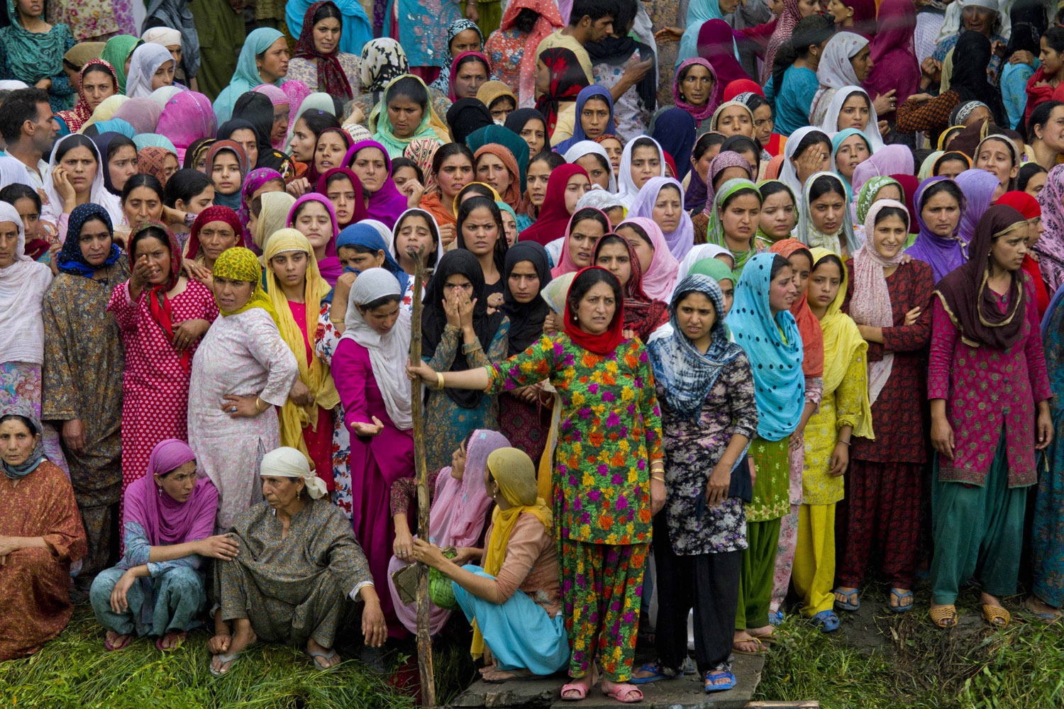 Aug. 11, 2012. Kashmiri Muslim women watch volunteers and rescue workers search for missing people in the water of Dal Lake in Srinagar, India, after the collapse of a wooden bridge injured dozens.