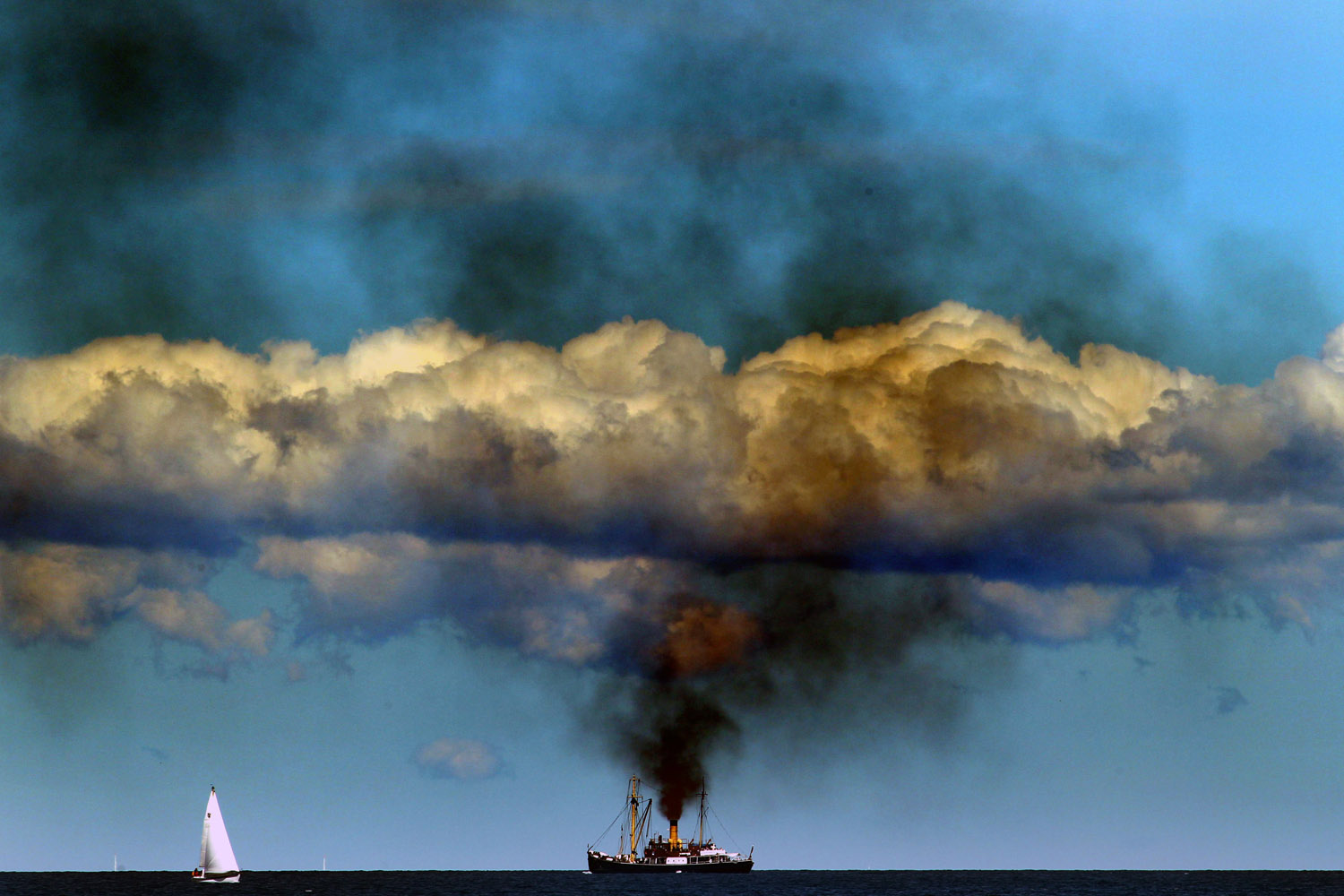 Aug.11, 2012. The German steam boat  Bussard,  built in 1905, parades on the Baltic Sea during the  Hanse Sail  sailing festival in Rostock, northeastern Germany.
