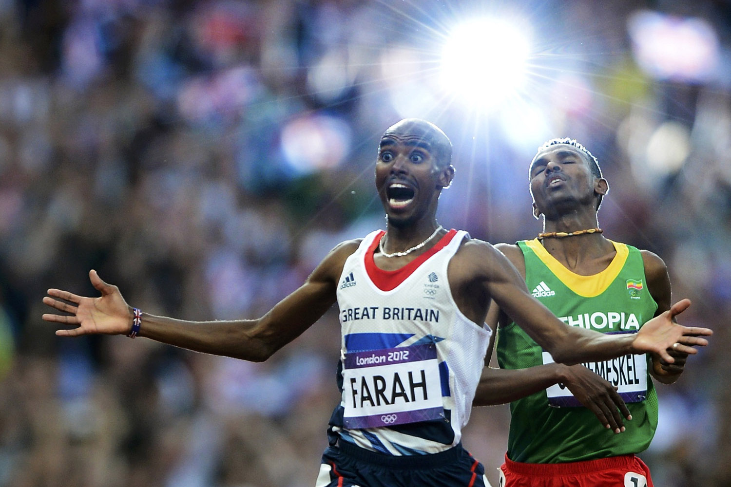 Aug. 11, 2012. Britain's Mo Farah reacts as he wins the men's 5000m final ahead of Ethiopia's Dejen Gebremeskel at the London 2012 Olympic Games at the Olympic Stadium.