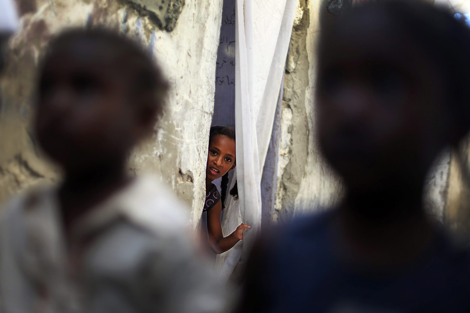 Aug. 11, 2012. Palestinian refugee children play in front of their house before Iftar, or breaking of the fast, during the Muslim Holy month of Ramadan in Al-Shabora refugee camp in Rafah City, Gaza.