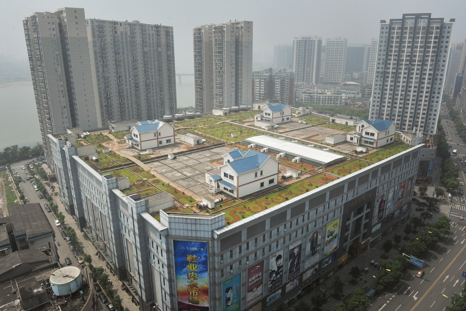 Aug. 14, 2012. Villas are seen on the top of an eight-story shopping mall in Zhuzhou, China.