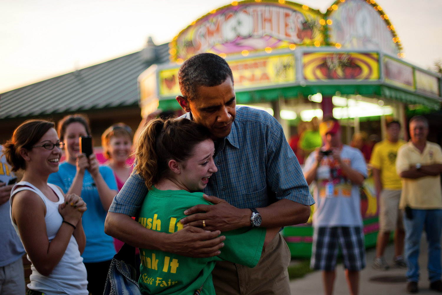Aug. 13, 2012. President Barack Obama gets a hug from Joy Dannelly as he visits the Iowa State Fair in Des Moines.