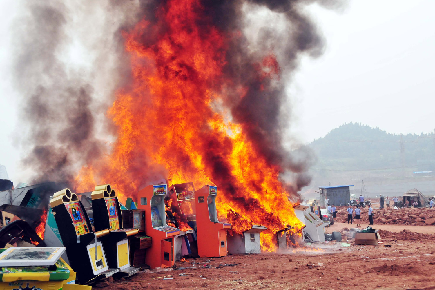 Aug. 14, 2012. Gambling machines are destroyed in Renjiagou village in Shunqing District, Nanchong City, southwest China's Sichuan Province.