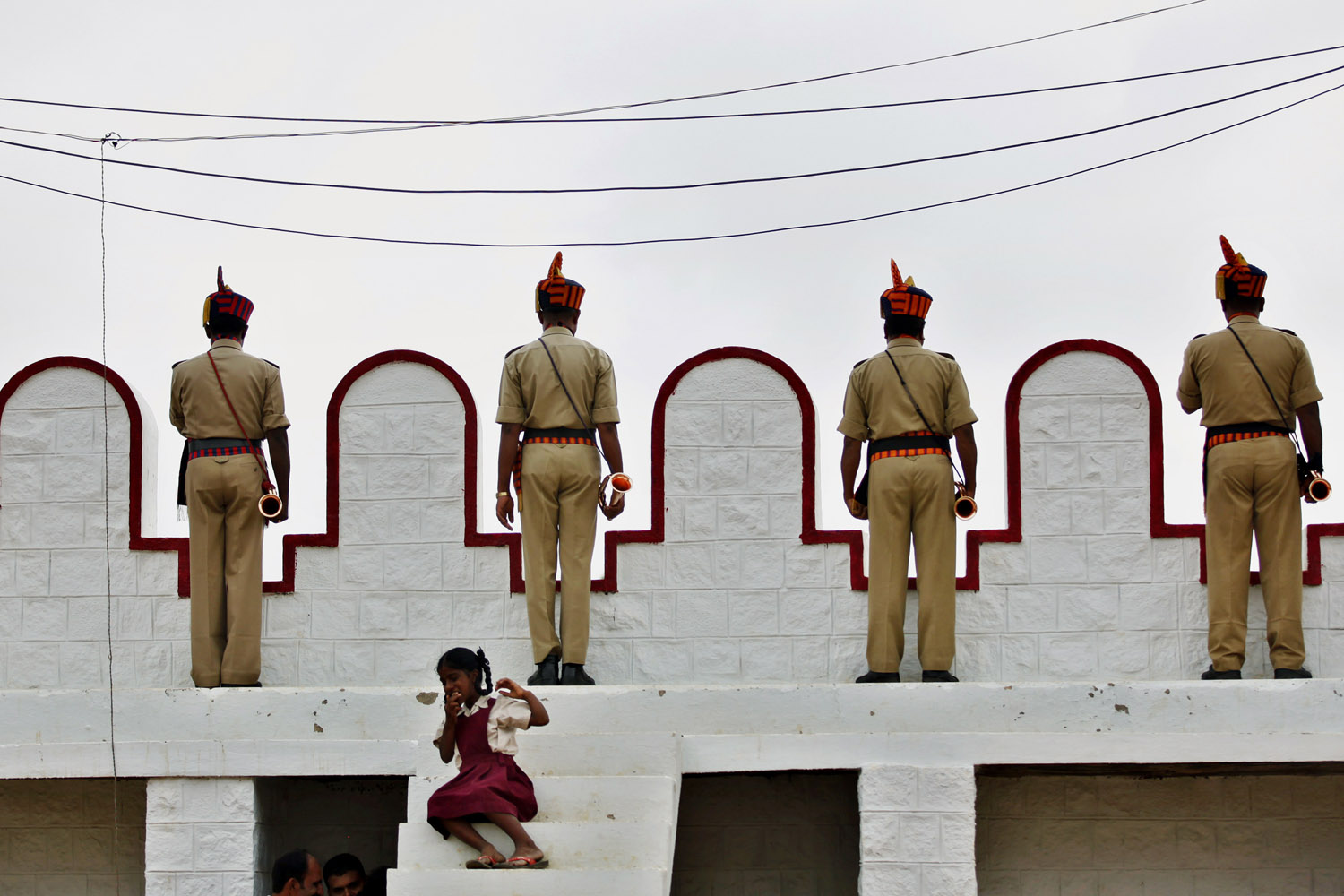 Aug. 15, 2012. Police wait with their trumpets to perform during a gathering to celebrate the 65th anniversary of India's independence from British rule, in Bangalore, India.