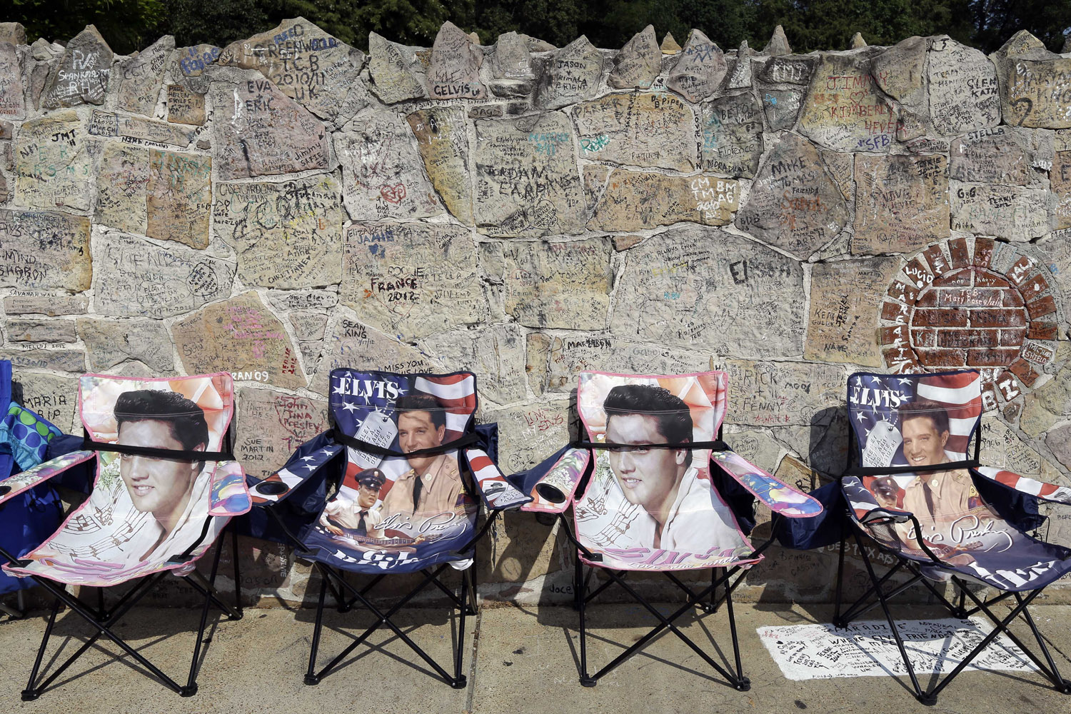 Aug. 15, 2012. Elvis Presley chairs hold spots for people waiting outside Graceland. Fans are lined up to take part in the annual candlelight vigil marking the 35th anniversary of Presley's death.