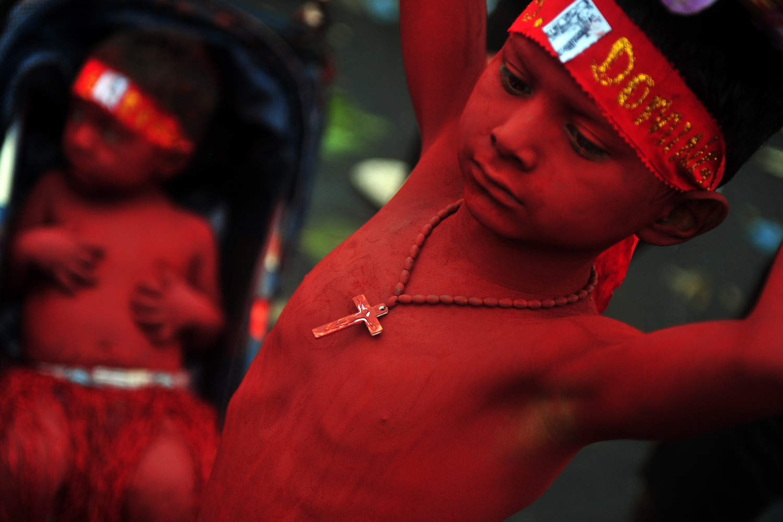 Aug. 10, 2012. Painted children take part in the festivities held in honor of Santo Domingo de Guzman, Managua's patron saint.