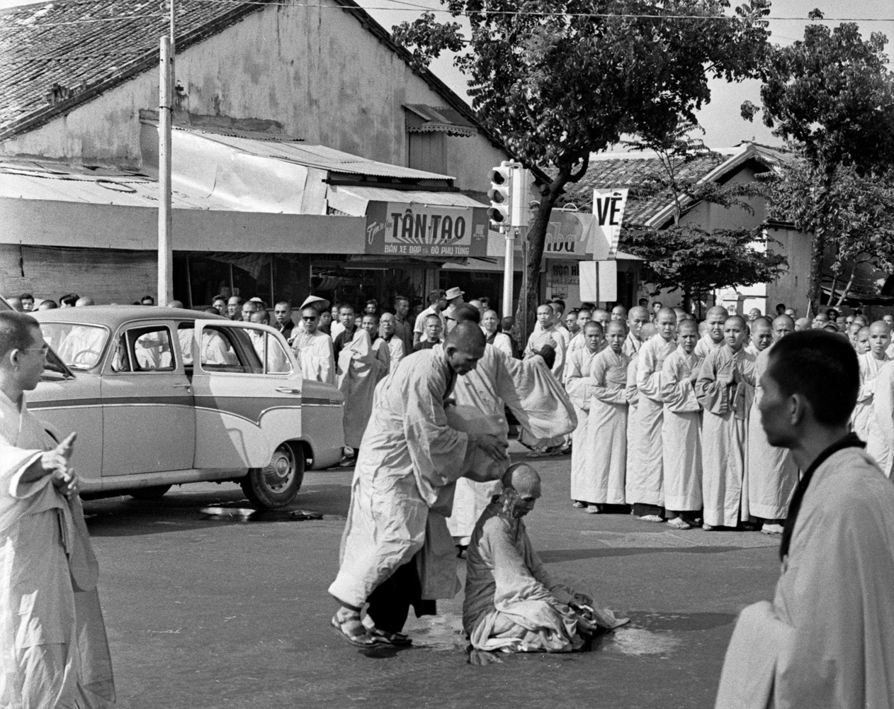 Buddhist monk Quang Duc emerged from a car and sat in the center of the intersection while a younger monk poured gasoline over him.