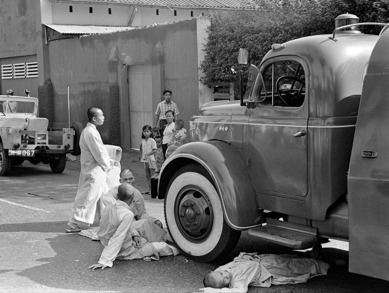 After the immolation, monks prevent a fire truck from approaching the scene.