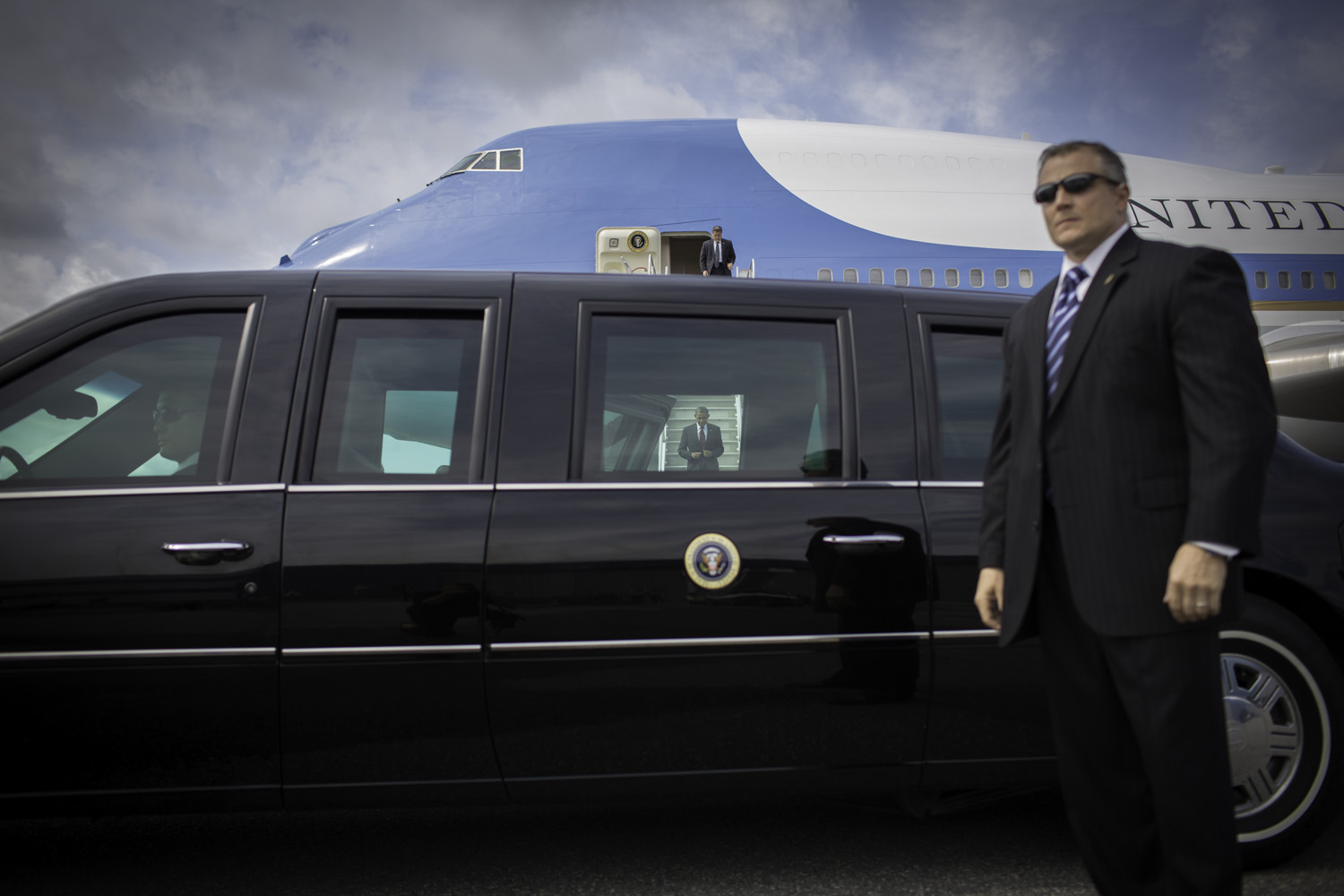 All photographs taken Aug. 18, 2012President Obama exits Air Force One upon arriving at the airport in Manchester, N.H.