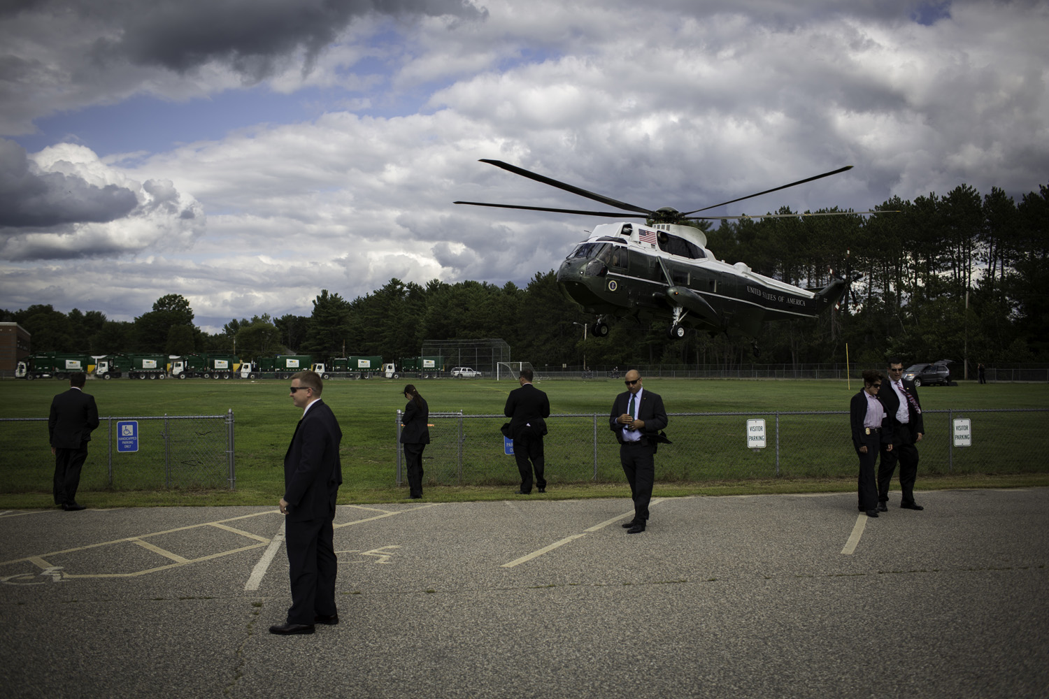 Secret Service agents wait as President Obama lands in Rochester.