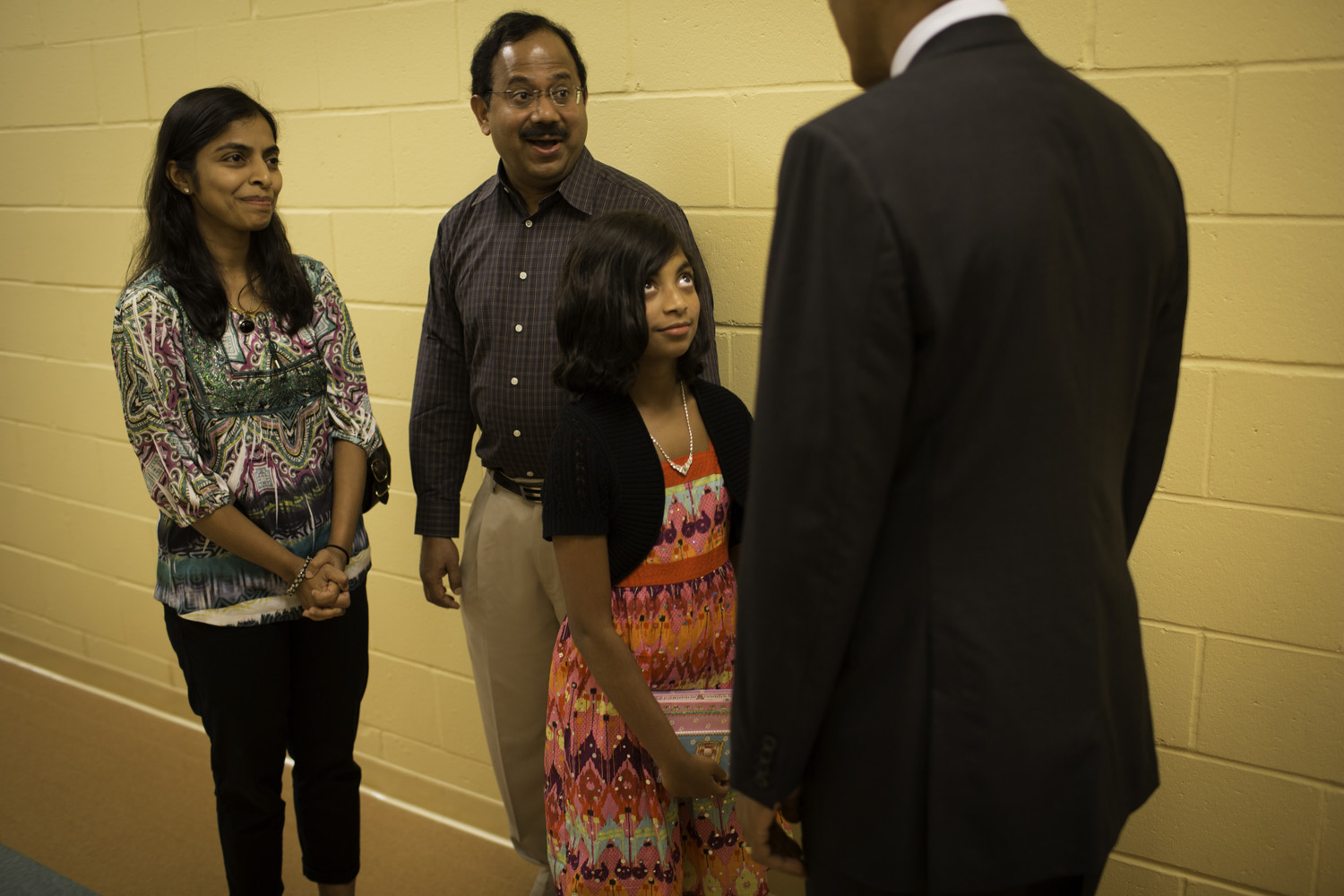 President Obama greets a young supporter and her family at Windham High School.
