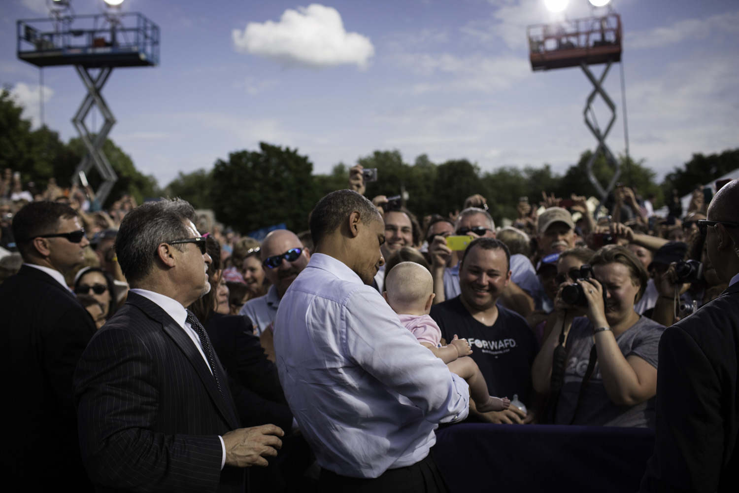 After speaking, President Barack Obama greets a young supporter during a rally at the Rochester Commons in Rochester.