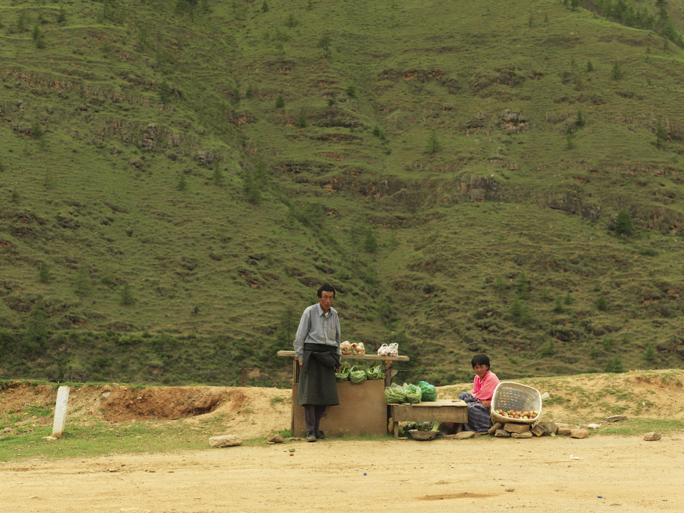Farmer couple Lendup and Sangay sell apples on the highway that links Paro and Thimphu.