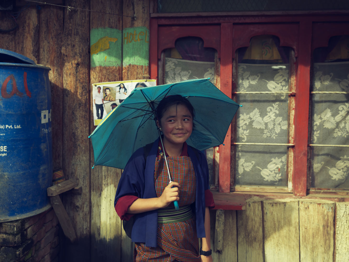 Dongka, a student, returns home after school in Punkaha town.